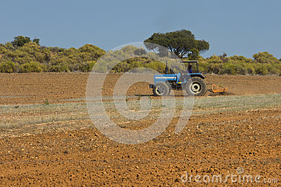 Tractor ploughing land