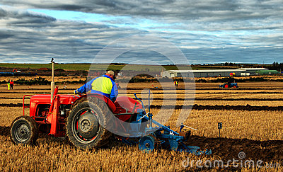Tractor and Ploughing Editorial Stock Photo