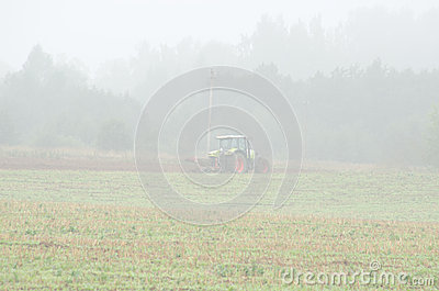 Tractor plow field morning agriculture works fog