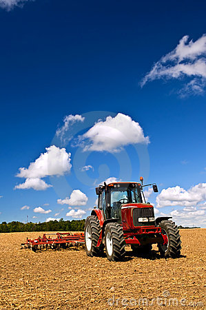 Tractor In Plowed Field Royalty Free Stock Photography - Image: 12613407