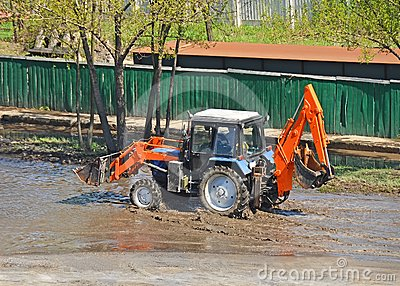 Tractor in a puddle