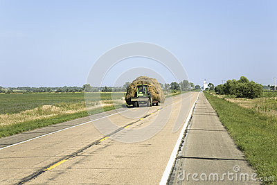 Tractor pulling hay down Editorial Image