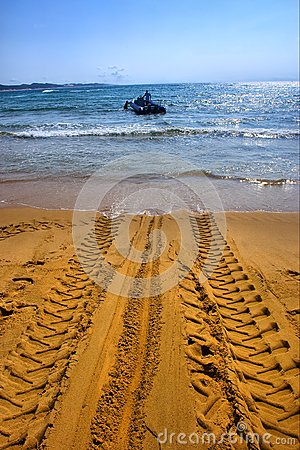Tractor s wheel mark on beach