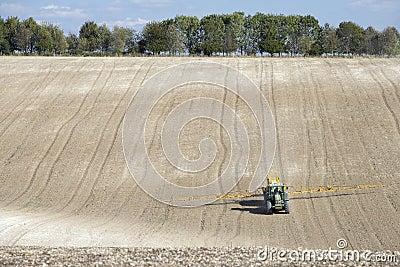 Tractor Spraying Field