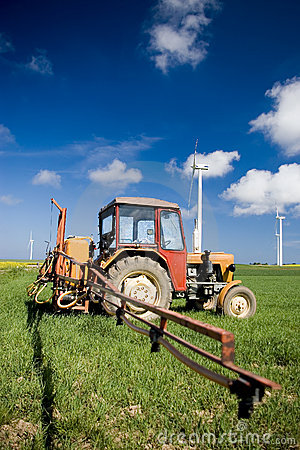 Free Tractor Spraying Green Field Stock Photography - 2431622