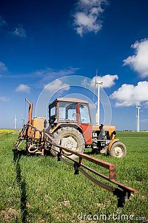 Tractor spraying green field