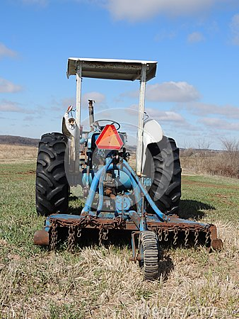 Tractor in Spring field with slow moving vehicle e