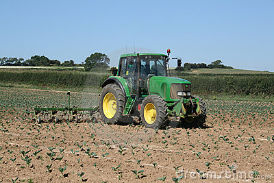 Tractor working in field Editorial Stock Image