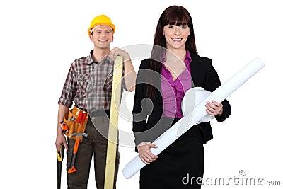 Tradesman admiring a female engineer