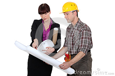 Tradesman consulting with an engineer