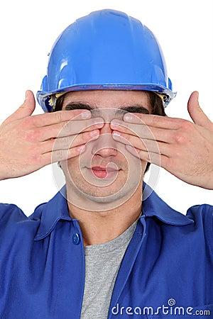 Tradesman covering his eyes