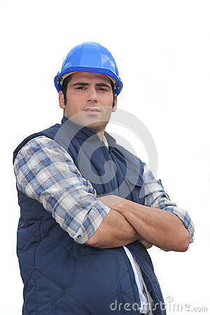 Tradesman with his arms crossed