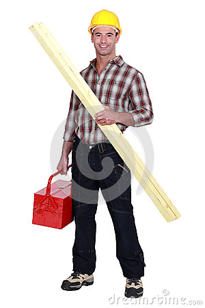 Tradesman holding a wooden plank