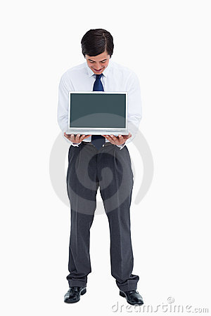 Tradesman looking at laptop screen