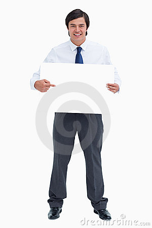 Tradesman pointing at blank sign in his hands
