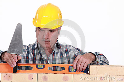 Tradesman using a level
