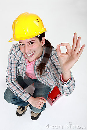 Tradeswoman giving the ok sign