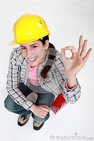 Tradeswoman giving the ok sign