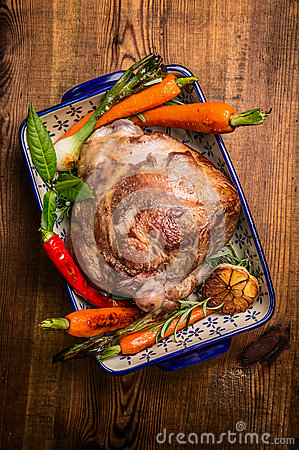 Free Tradition Roasted  Lamb Leg With Carrot And Fresh Herbs In Rustic Bowl On Wooden Background Stock Photography - 56260912