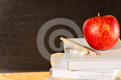 Traditional academic study school books and apple