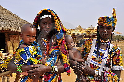 Traditional african dresses, women with children Editorial Photo