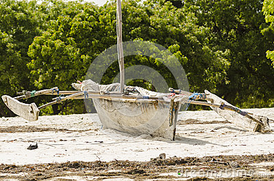 Traditional african fishingboat on beach