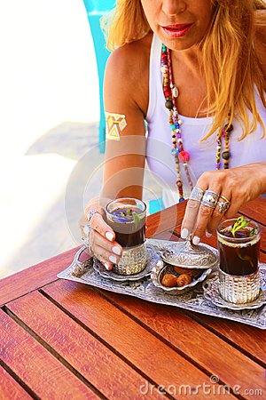 Free Traditional Arabic Tea Set With Dates, Blonde Caucasian Woman Stock Photos - 108902583