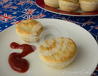 Traditional Australian Meat Pies And Tomato Sauce.