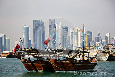 Traditional boats and the Doha skyline Editorial Photography