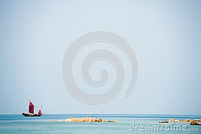 Traditional Chinese Junk boat on the horizon