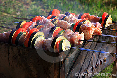 Traditional cooking meat on skewers
