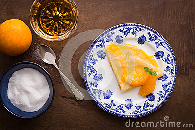 Traditional crepe suzette on wooden table