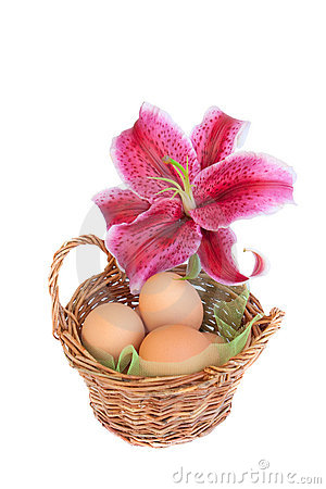 Traditional easter basket with lily flower