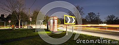 Traditional english phonebox at night