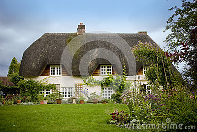 Traditional English thatched country cottage