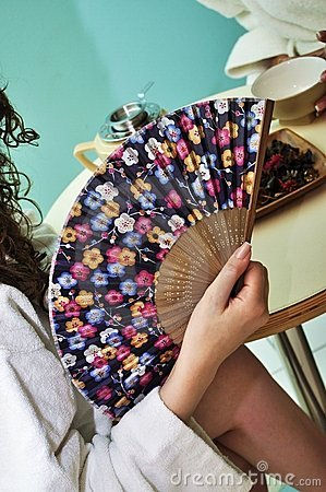 Traditional fan in woman hand