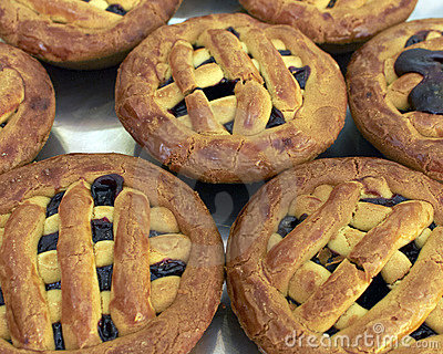 Traditional Greek small pies with cherry jam