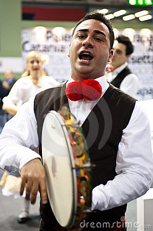 Traditional italian singer at BIT 2012 Editorial Photography