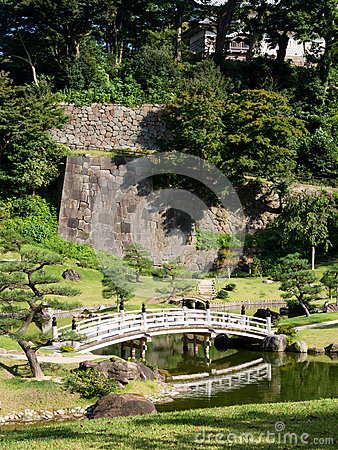 Free Traditional Japanese Landscape Garden With Pond And Wooden Arched Bridge Royalty Free Stock Photo - 66915705