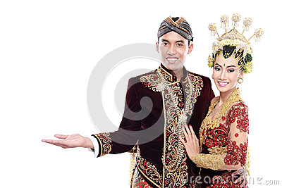 Traditional java wedding couple husband and wife presenting blan