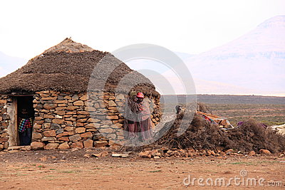 Traditional lesotho house and people