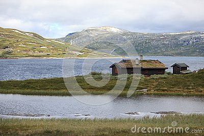 Traditional Norwegian House In Rugged Landscape Stock Image - Image: 15358791