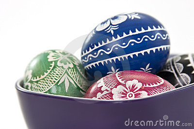 Traditional polish easter eggs in violet cup