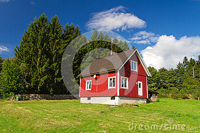 Traditional red Swedish house at the forest