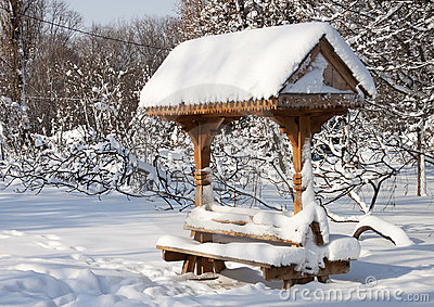 Traditional resting place in snow - RAW format