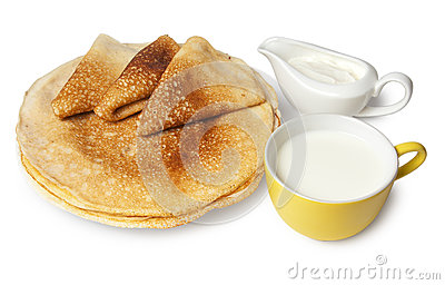 Traditional russian pancakes with sour cream and milk