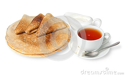 Traditional russian pancakes with sour cream and tea