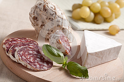 Traditional salami cheese brie, grapes, basil