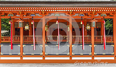 Traditional shinto architecture and stone lanterns at Fushimi In Editorial Stock Photo