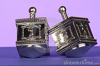 Traditional silver dreidels
